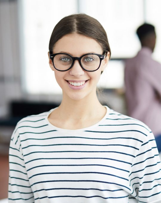contemporary-young-businesswoman-smiling-at-camera-72SN9FN.jpg